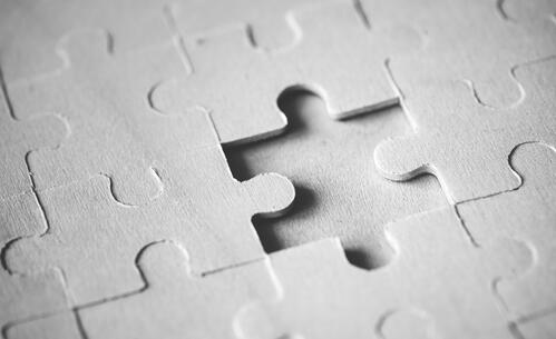 macro-shot-jigsaw-puzzle-missing-solution-concept-FZLMGZD